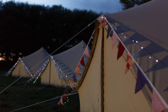 Bell tents fairy lights and bunting - a glamping essential in our books!