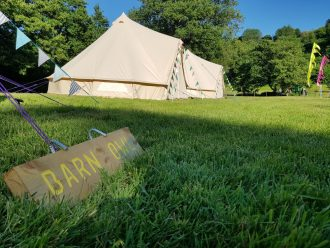 Bell tents set up for corporate booking with Fiesta Fields