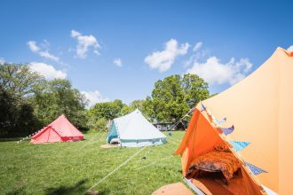 Coachella camp with colourful bell tents, set up near the New Forest for hen parties