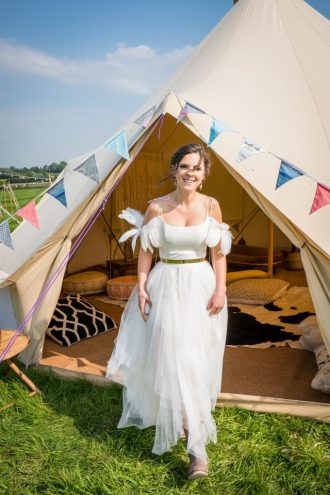 Festival wedding photo shoot, bride in boho wedding dress and our 7m chill out bell