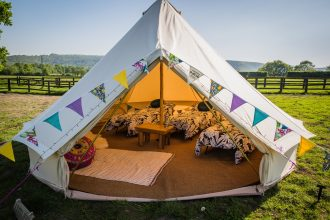 5m cream bell tent with camp beds and memory foam toppers