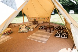 7m chill out bell tent with tropical cushions and wool rugs