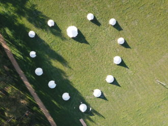 Bell tents set up in love heart shape