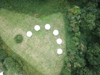Drone shot of a wedding guest village at Two Woods wedding venue in Pulborough