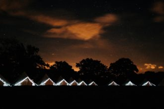 Bell tents at night! The fairy lights really do add to the atmosphere