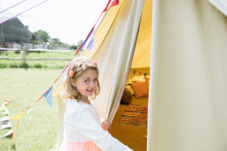 Bridesmaid enjoying our 7m chill out bell as part of our gleaming wedding services