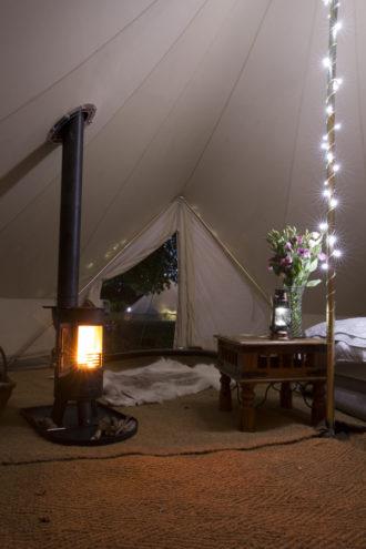 Interior of Snug wedding bell tent with log burner