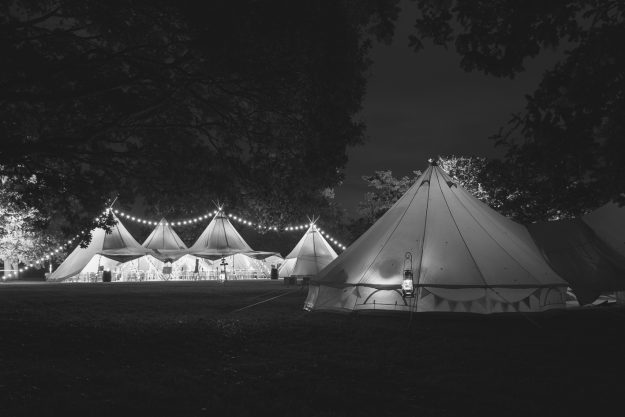 Black and white picture of bell tent and Kata Tipis for outdoor weddings in West Sussex, Hampshire and Surrey