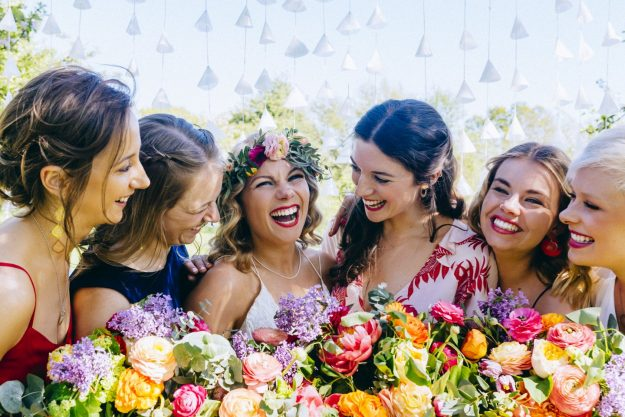 Bride with flower crown and bridesmaids at the Secret Barn