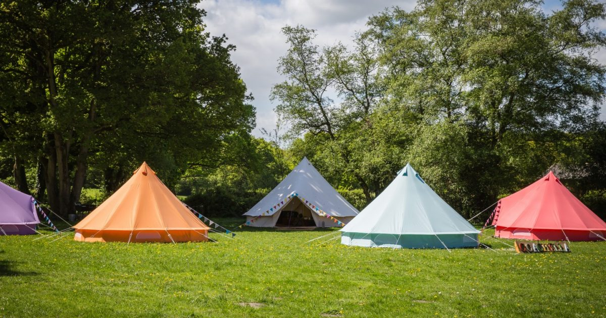 Exterior picture showing coloured bell tents for Coachella hen camp area