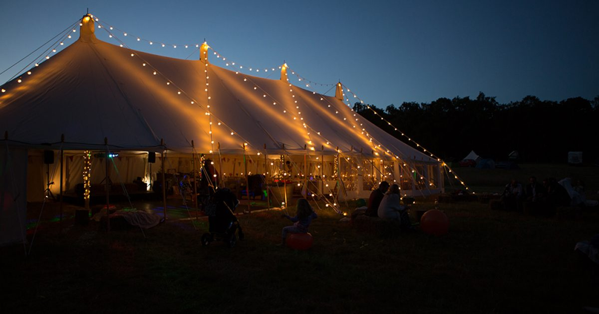 Pole marque lit up at night with festoon lights