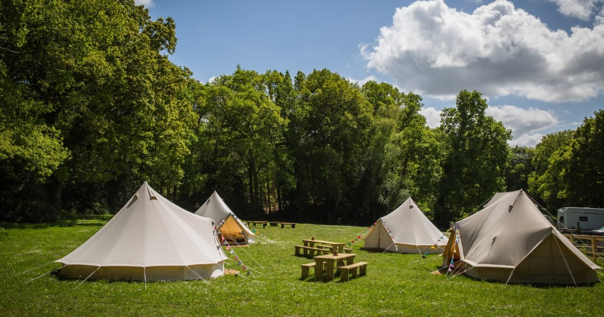 Exterior shot showing sleeping tents and emperor tent at hen camp