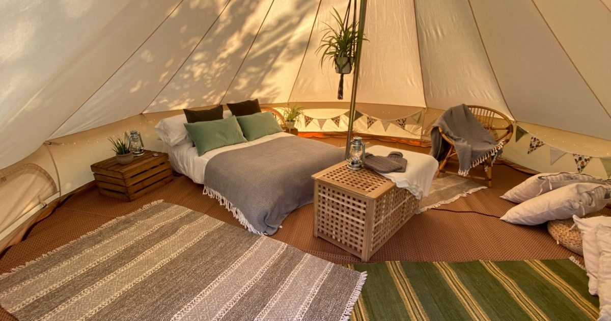 Interior of 5m date night den bell tent. For hire in Hampshire and surrounding areas