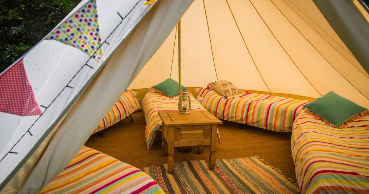 Interior shot of one of our sleeping tents at hen camp. Exclusive hen party bell tent hire in Hampshire, Dorset and the New Forest