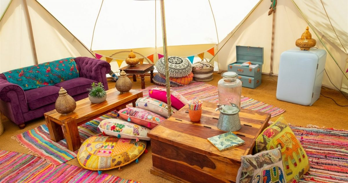 Interior picture of 7m chill out bell tent for 2018 / 2019 season. Hen camp chill outsells come with plenty of soft furnishing and give you a communal space to celebrate your hen party weekend!