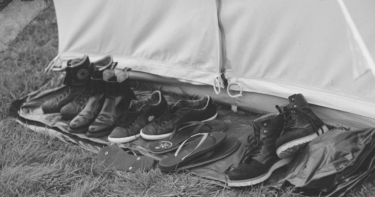 Shoes outside door of bell tent after the party. Bell tent hire for events and weddings.