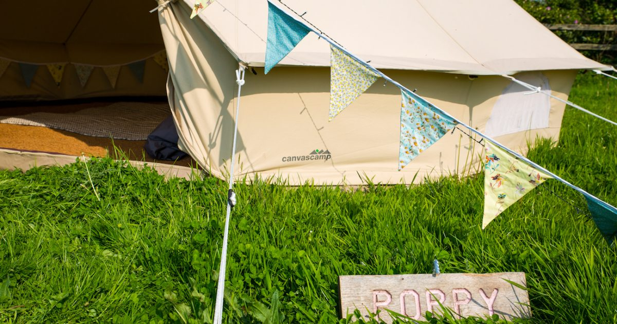 Exterior of 4m bell tent for hire in West Sussex. Bell tent hire for events.