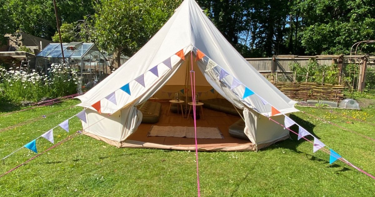 Exterior of 5m bell tent for click and collect garden glamping