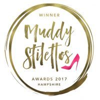 Picture of Muddy Stilettos winers badge for 2017 that Beautiful Bells won for best gleaming provider in Hampshire for glamping.