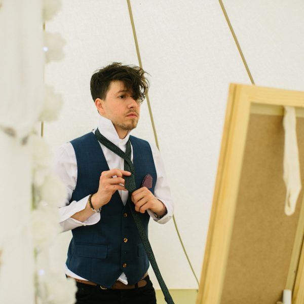 Stuart getting ready inside wedding bell tent. Wedding inspiration. Bell tent hire West Sussex