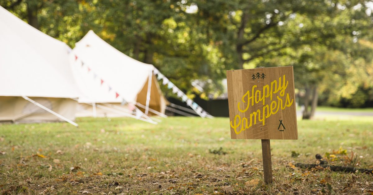 Beautiful Bells glamping village and happy camper sign