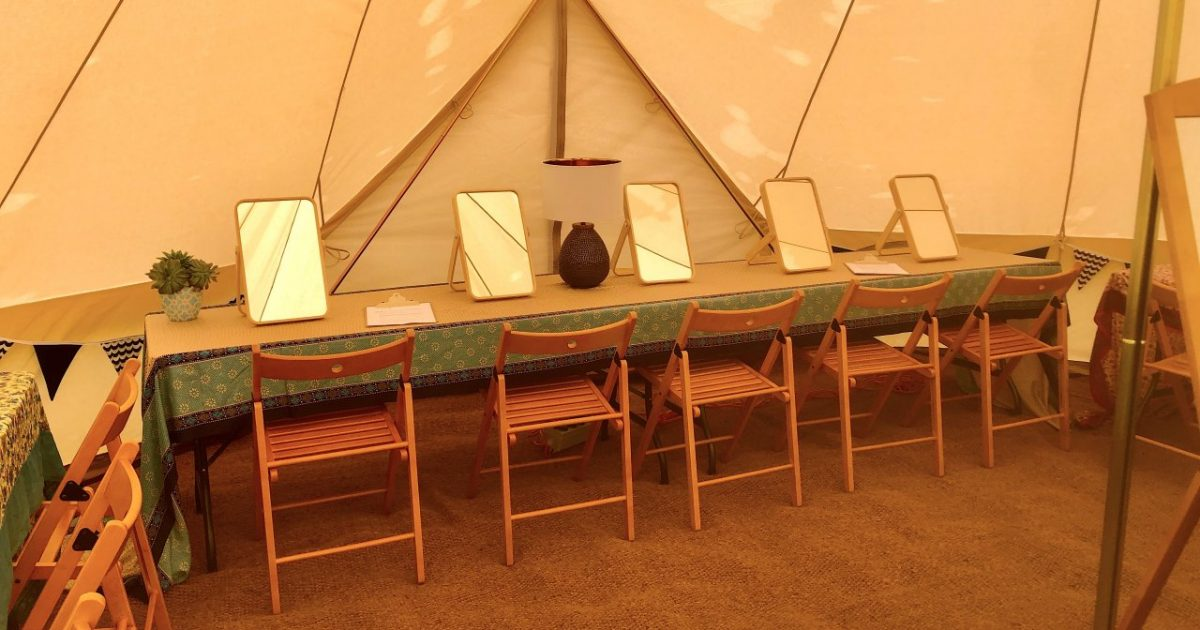 Interior of 7m pamper bell tent, showing our Indian silk sari's. Pamper tent hire for weddings and events.