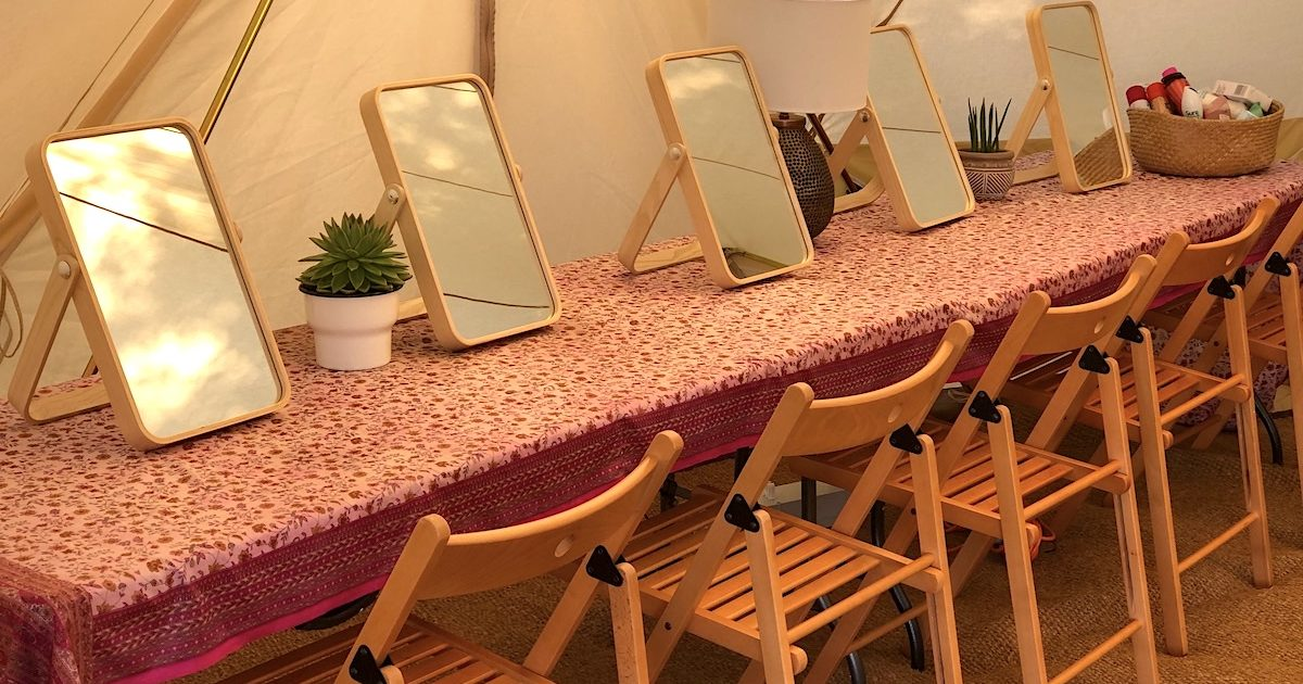 Interior of 7m pamper bell tent with table top mirrors and folding wooden chairs Pamper tent hire for weddings and events.