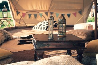 Beautiful Bells 7m chill out bell tent, decorated with cushions and tables