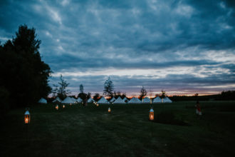 Lanterns lighting the way to the bell tent pop up hotel
