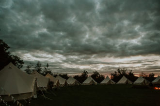 We think our glamping tents come to life as the sun goes down - Oxford bell tent village at sunset
